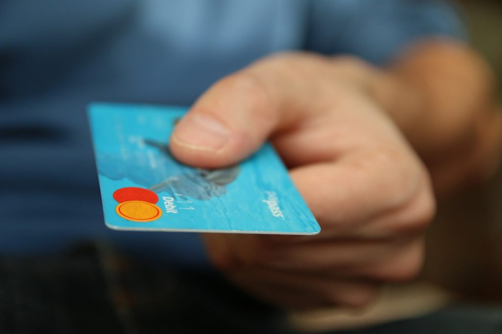 employee compensation man holding a card
