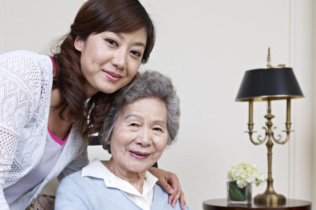 senior asian woman and her nursing care service provider