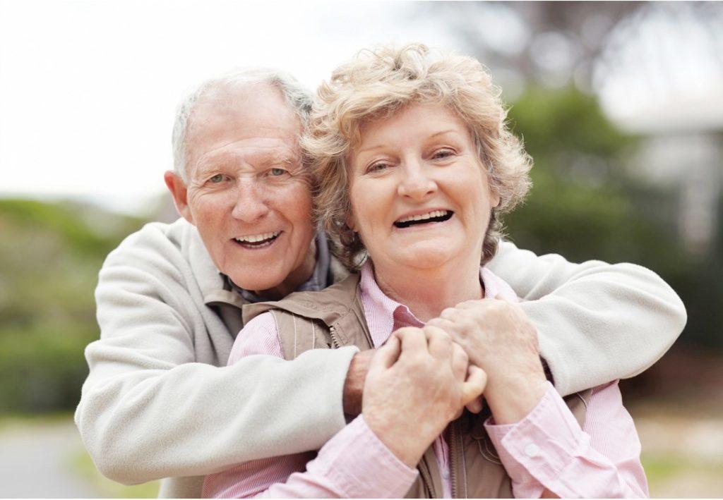 speech therapy elderly hugging couple