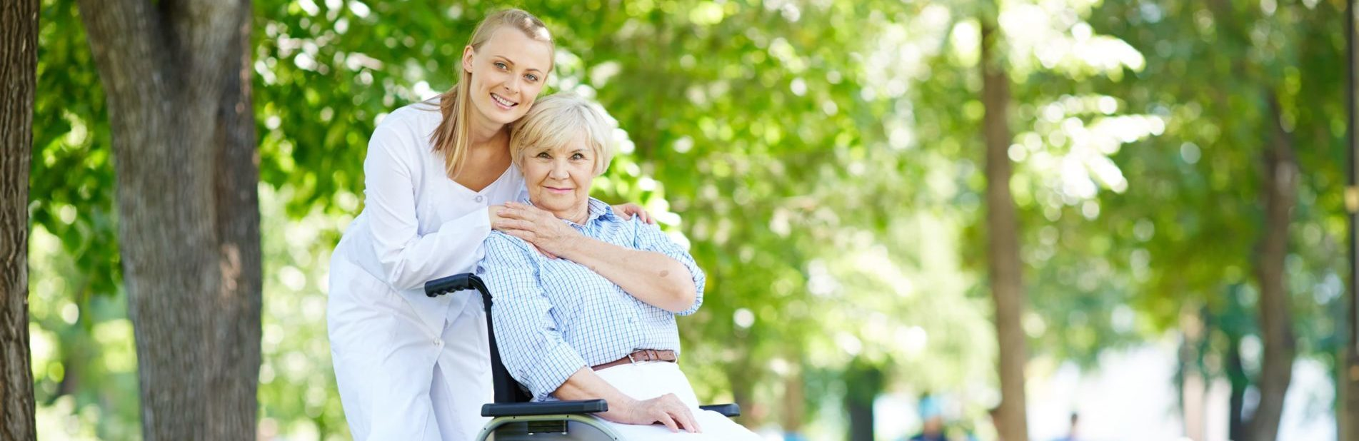 pretty nurse with a senior patient in a wheelchair Open Door Home Care