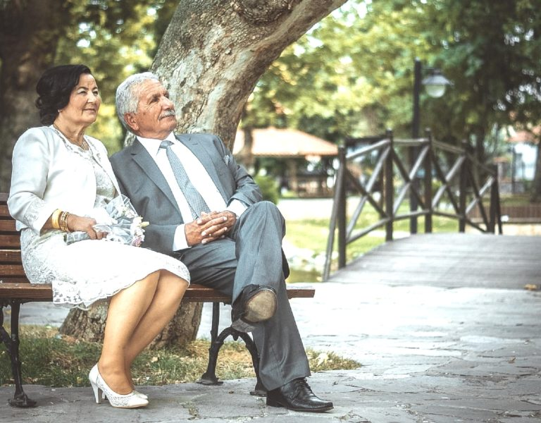 a couple of elderly enjoy their life and having a rest in a park